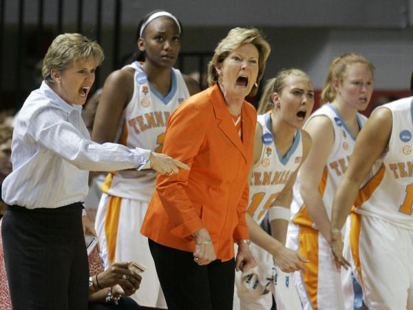 During the second half of a 2009 game that Tennessee lost to Ball State, Pat Summitt and assistant Holly Warlick react from the bench.