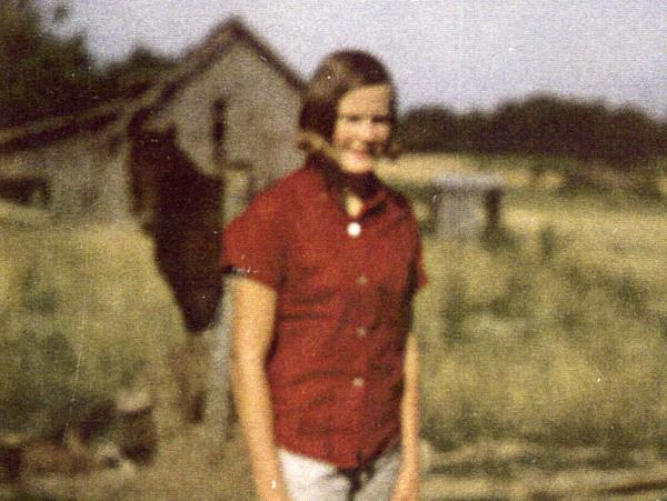 "Pat Summitt, the skinny girl they called ""Bone,"" standing in front of the hay barn where she played ball with her brothers."