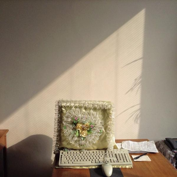 """A frilly dust cover protects a desktop computer inside a #Pyongyang, North Korea office."""