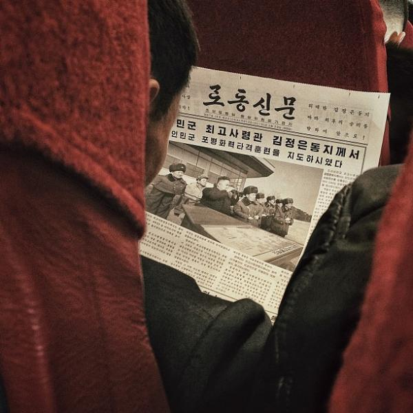 """A North Korean passenger aboard a North Korean Air Koryo flight from #Pyongyang to Beijing reads a newspaper article about leader Kim Jong Un."""