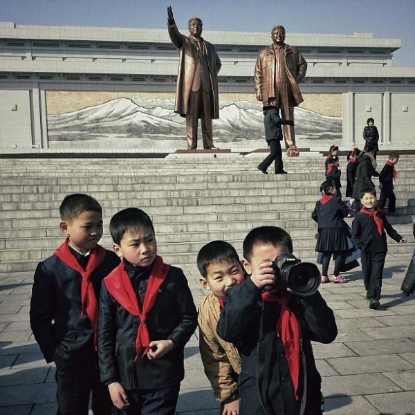 "Posted Feb. 16: ""This little North Korean dude and his school buddies, were playing with one of my cameras this morning at Mansu Hill in #Pyongyang."""