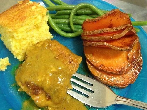 """From Dayton, Ohio, <a href=""""http://dinnertimeconfessional.tumblr.com/post/44522407895/dinner-for-my-babies-miles-5-micah-3#posts"""">TPC</a> shares her dinner: """"Sweet Potatoes with a cinnamon-spiced agave drizzle, served with haricot vert (french green beans), and curried chicken (thighs) and cornbread."""""""