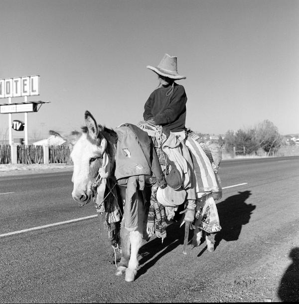 "Judy Majers, known as ""the Burro Lady,"" makes her way around the Big Bend region. Evans asked to take her portrait many times and she would kindly say, ""No, thank you."" After 19 years, she finally said yes."