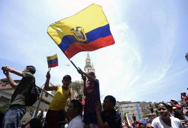 Supporters of the late Venezuelan President Hugo Chavez wait for the passage of the funeral cortege on its way to the Military Academy, on Wednesday, in Caracas.