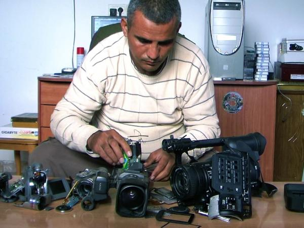 Emad Burnat, a Palestinian who co-directed the Oscar-nominated documentary<em> 5 Broken Cameras</em>, displays the cameras destroyed by Israeli settlers and security forces.
