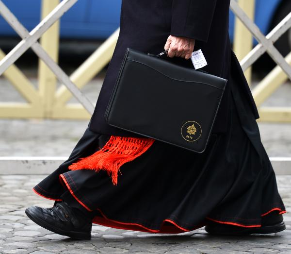 Roman Catholic cardinals have been meeting at the Vatican to get to know each other better and to set a date for the start of the conclave that will choose the next pope. On Thursday, this cardinal was walking to one of those meetings.