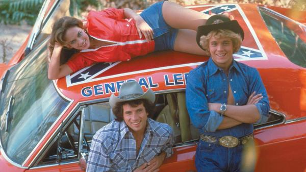 Tom Wopat (left), John Schneider and Catherine Bach played Luke, Bo and Daisy Duke — rowdy country cousins in a Georgia town — in the '80s TV series <em>The Dukes of Hazzard.</em>