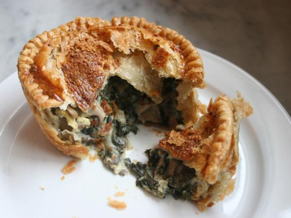 Mushroom And Kale Pie, shown here as a single-serving pie at Pleasant House Bakery.