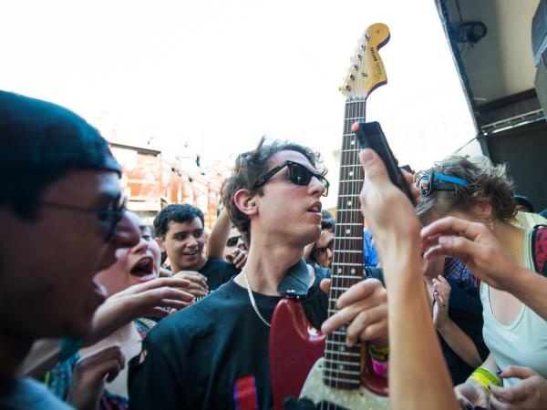 A member of Beach Fossils jumps into the crowd at The Mohawk.
