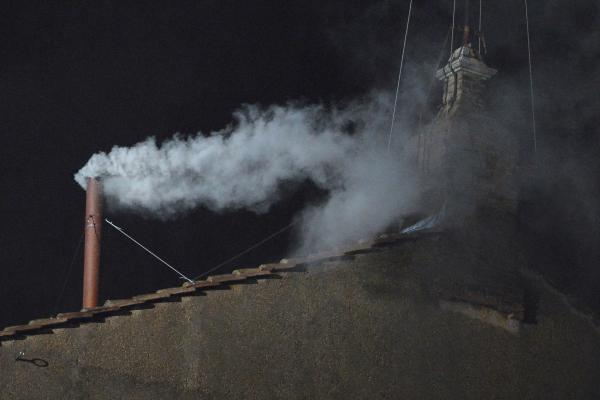 White smoke rises from the chimney on the Sistine Chapel during the second day of the cardinals' secret conclave at the Vatican.