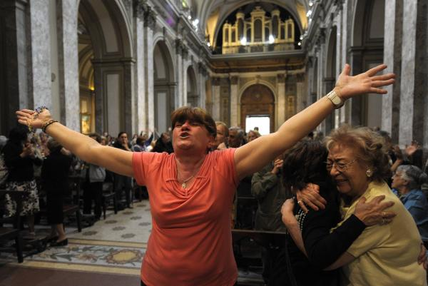 Catholics react after the announcement that Buenos Aires Archbishop Jorge Mario Bergoglio was elected pope, at Metropolitan Cathedral in Buenos Aires on Wednesday. He is the first Jesuit to become pope.