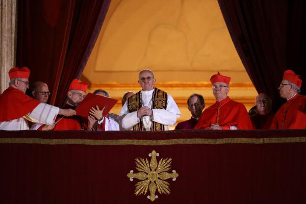 The newly elected pope appears on the balcony of St. Peter's Basilica.
