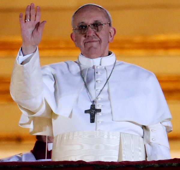 Pope Francis waves to the crowd in St. Peter's Square at the Vatican on Wednesday.