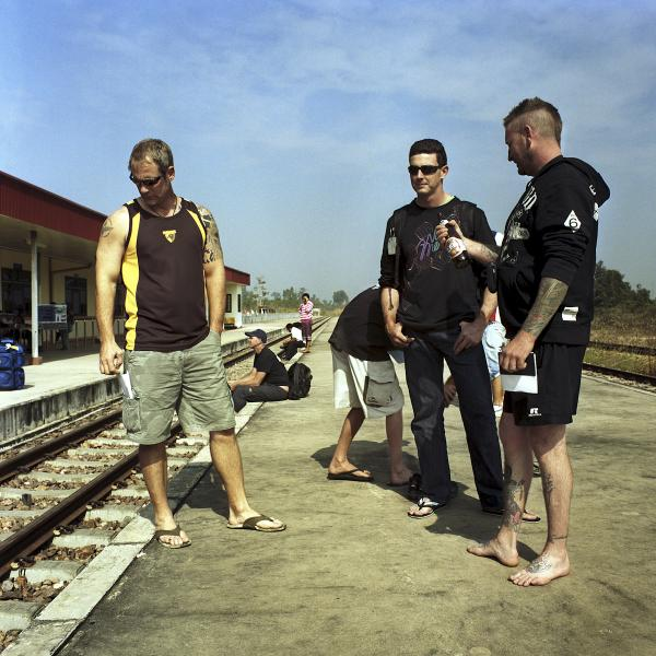 At the Thanaleng station, a group of Australian tourists await the train to Nongkai, where they will catch the connecting train to Bangkok.