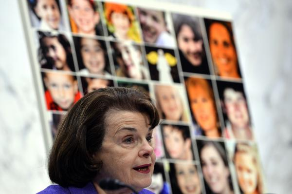 "Pictures of Newtown's Sandy Hook Elementary School shooting victims are displayed as Senate Judiciary Committee chairperson Dianne Feinstein speaks during a hearing on ""The Assault Weapons Ban of 2013"" at the Hart Senate Office Building in Washington, DC, on February 27, 2013."