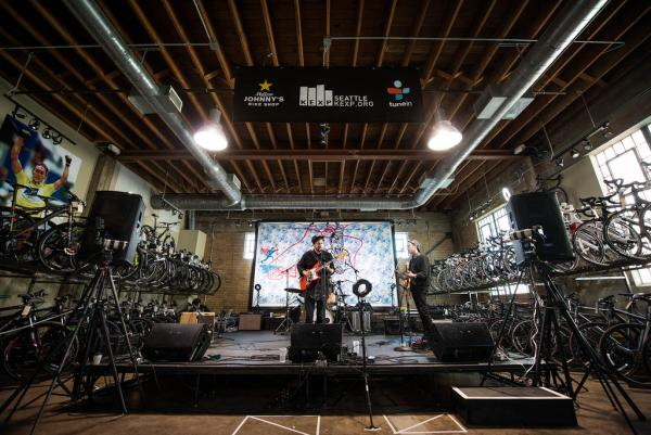 Framed by racks of bicycles, Unknown Mortal Orchestra plays the KEXP showcase at Mellow Johnny's.