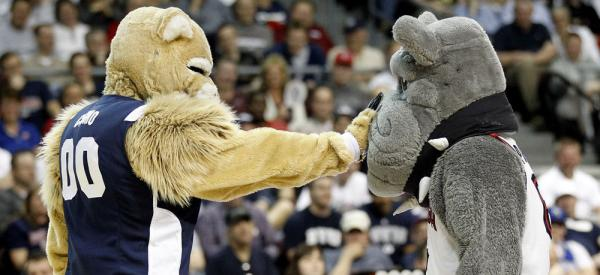 Cosmo the Cougar, left, and Spike the Bulldog during a timeout of at an NCAA college basketball game.