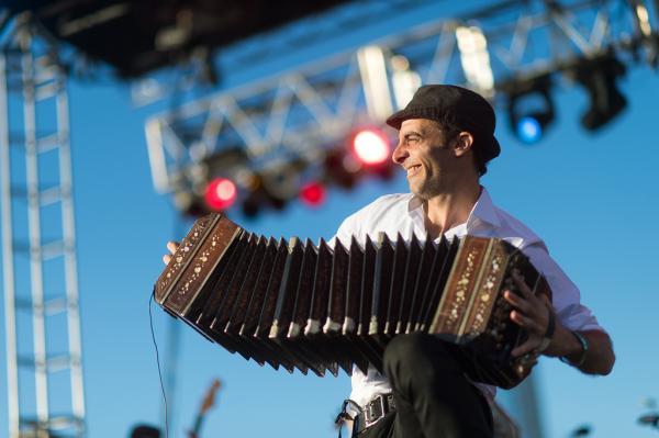 Bajofondo's Martín Ferrés stretches out his bandoneón as far as he can at <em>Alt.Latino</em>'s SXSW showcase.