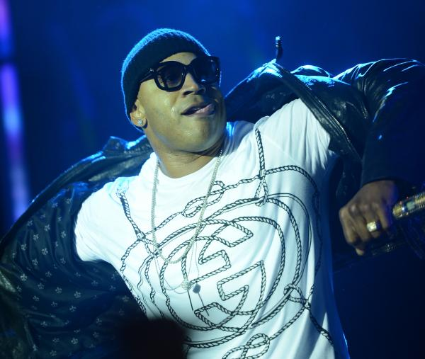 Underneath a stage shaped like a 62-foot vending machine, LL Cool J plays an outdoor set at SXSW 2013.