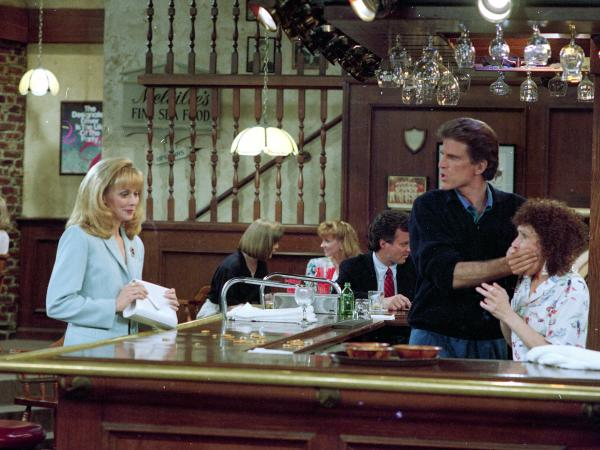 Ted Danson, playing the role of bartender Sam Malone, keeps Rhea Perlman, playing waitress Carla Tortelli, under control as Shelley Long, portraying Diane Chambers, left, returns to the set of <em>Cheers</em> during taping of the final episode in 1993.