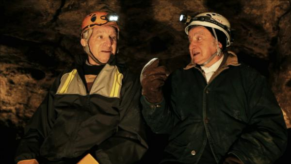 Sam and Saul Stermer, members of a family who hid in an underground Ukrainian cave in the early days of World War II, return to the hideout in <em>No Place on Earth.</em>