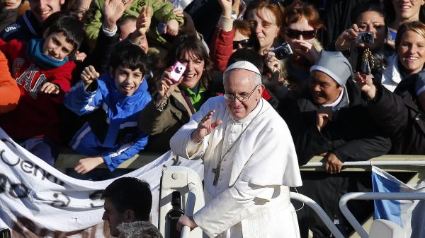 Greeting the faithful: Pope Francis as he arrived in Vatican City's St. Peter's Square on Tuesday for his inaugural mass.