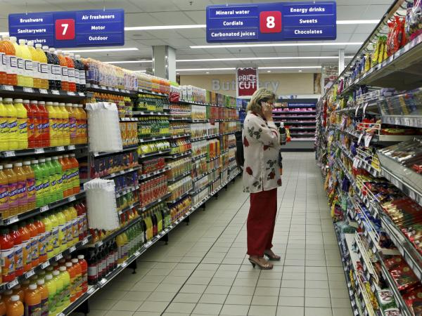 A shopper at a branch of South African retailer Pick n Pay in Johannesburg. Health insurer Discovery offers rebates on health food at the chain to its members who enroll in a health promotion program.