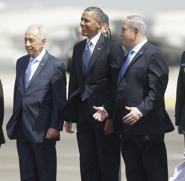 President Barack Obama is greeted by Israeli President Shimon Peres, left, and Israeli Prime Minister Benjamin Netanyahu upon his arrival ceremony at Ben Gurion International Airport in Tel Aviv, Israel, on Wednesday.