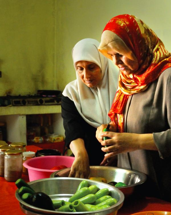 "Members of the Zeitun Women's Cooperative prepare a meal. These women take catering orders for special events, using the proceeds to help support their families in an area with ""nearly universal male under- and unemployment,"" the authors of <em>The Gaza Kitchen</em> write."