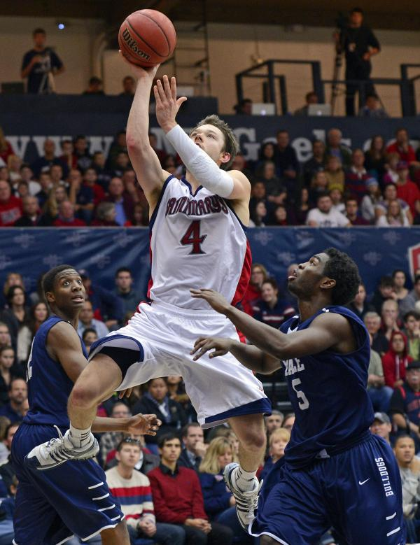 St. Mary's' Matthew Dellavedova goes up for a basket against Yale Bulldogs' Justin Sears and Michael Grace.