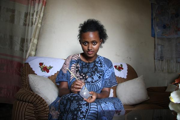 Woman sculpting a clay pot in Addis Ababa, the capital of Ethiopia, June 2011.