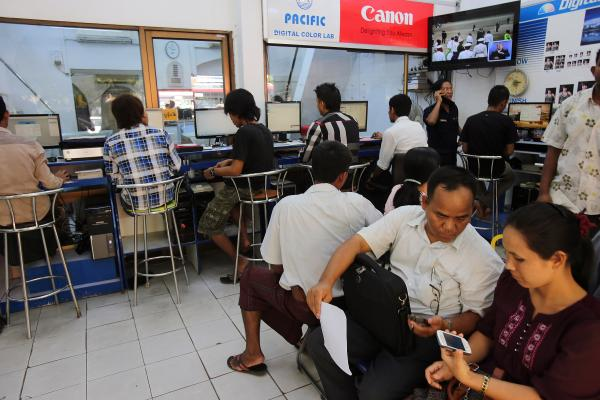 Customers at an Internet and multimedia services store in Yangon, Myanmar. The country is working to expand and improve Internet and mobile phone networks nationwide.