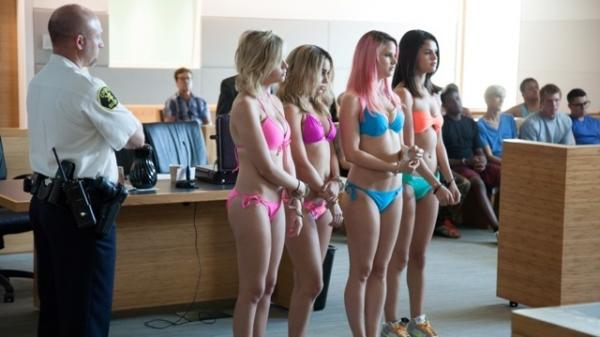 The girls of <em>Spring Breakers </em>(from left, Ashley Benson, Vanessa Hudgens, Rachel Korine and Selena Gomez) live in the kind of fluorescent world where skimpy bathing suits fit within court appearance dress codes.
