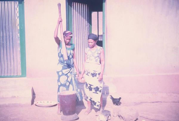 """Two women pounding yams. Yams are the staple food among the Tiv people, and around the whole country. ... Coming from a farm family, my mother must have been fascinated. The farm life of 1960s California was far removed from the farms of 1960s Nigeria."""