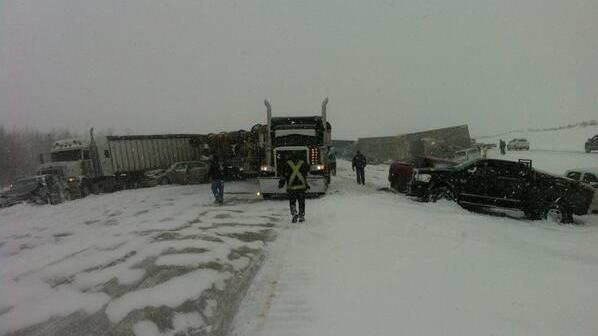 A blizzard traps cars, trucks and even a cattle car on a Canadian highway, causing dozens of mild injuries.