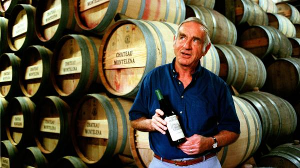 Jim Barrett, owner of Chateau Montelena in Napa Valley, holds a bottle of the 1973 chardonnay that won the 1976 Paris Tasting, in 1996. Barrett died Thursday at 86.