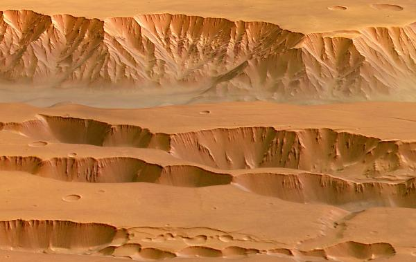 "Coprates Chasma in the <a href=""http://astrogeology.usgs.gov/geology/mars-valles-marineris"">Valles Marineris</a> on Mars, photographed <a href=""http://www.esa.int/Our_Activities/Space_Science/Mars_Express/Coprates_Chasma_and_Coprates_Catena"">by the Mars Express spacecraft</a>. Appearing in the top half of this image, it ranges from 60-100 km wide and drops 8-9 km below the surrounding plains."
