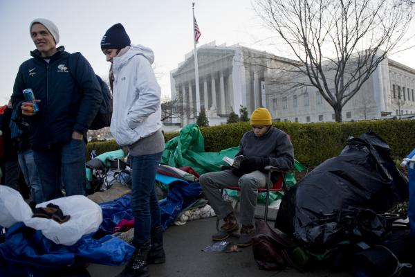 "Outside the court this morning, the crowd was so large ""you can't even move through it,"" NPR's Craig Windham said. People have camped for days outside the court to try to ensure a spot inside to hear oral arguments."