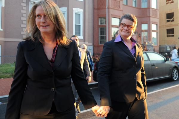<em>Hollingsworth v. Perry</em> plaintiffs Sandy Stier (left) and Kristin Perry head for the Supreme Court. They are challenging the constitutionality of Proposition 8, California's ban on same-sex marriage.