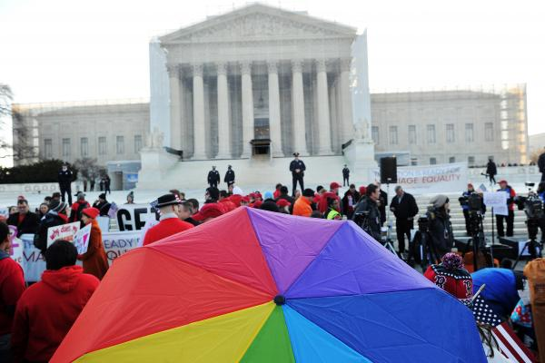 Supporters of same-sex marriage gather in front of the Supreme Court on Tuesday in Washington, D.C. Same-sex marriage takes center stage today as the justices begin hearing oral arguments on the emotionally charged issue that has split the nation.