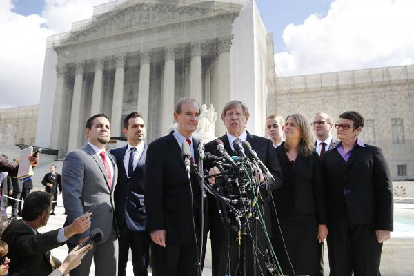 Lead attorneys David Boies (center left) and Theodore Olson (center right) talk to reporters outside the Supreme Court after arguing their case against California's Proposition 8 on Tuesday.