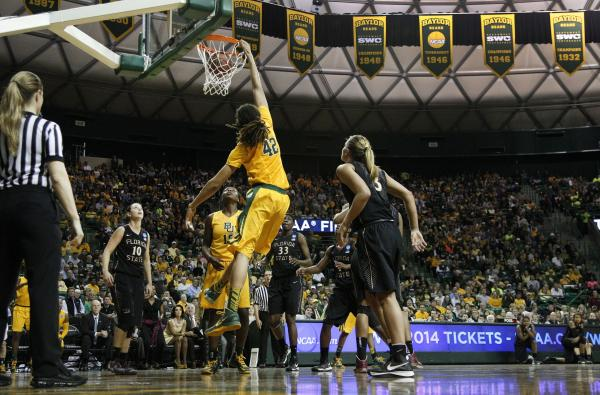 Baylor's Brittney Griner (42) dunks as Florida State's Leonore Rodriguez (10) and Alexa Deluzio (3) look on; Baylor defeated Florida State 85-47 on Tuesday in Waco, Texas.