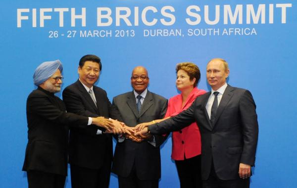 BRICS leaders, from left, Indian Prime Minister Manmohan Singh, Chinese President Xi Jinping, South African President Jacob Zuma, Brazil's President Dilma Rousseff and Russian President Vladimir Putin pose for a group picture during the BRICS 2013 Summit in Durban, South Africa, on Wednesday.