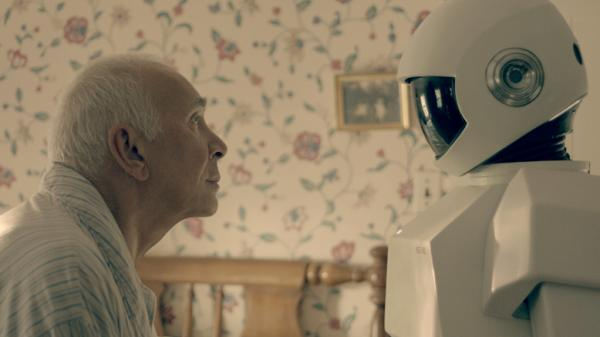"In <em>Robot & Frank</em>, a robot cares for an aging ex-burglar who has dementia. Frank Langella, who plays the burglar, says his character ""becomes fond of the robot only because it is a tool for his wicked, wicked ways."""