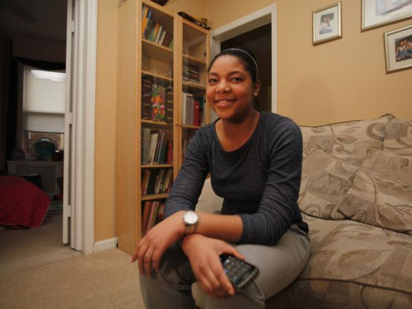 Khaliah Fitchette in her Newark home. (The cellphone she's holding is not the one she used to shoot video of officers).