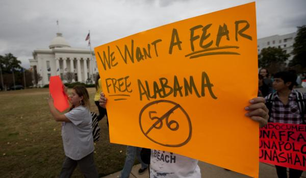 Protesters march outside Alabama's Capitol in Montgomery on Nov. 15 during a demonstration against the state's immigration law.