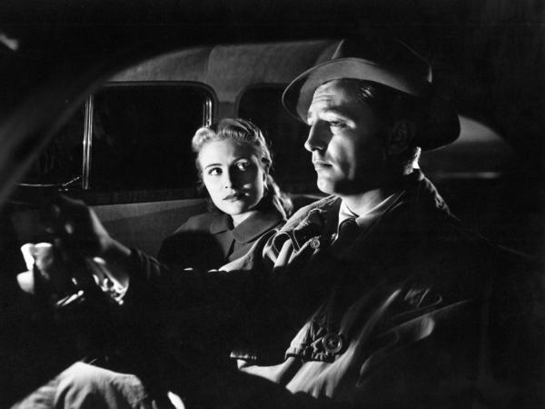 Virginia Huston and Robert Mitchum in a scene from the 1947 movie, <em>Out of the Past</em>.
