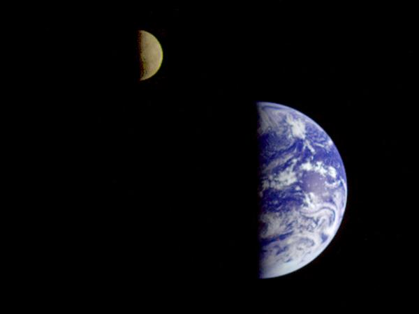 This image of the Earth and moon in a single frame, the first of its kind ever taken by a spacecraft, was recorded by Voyager 1 on Sept. 18, 1977.