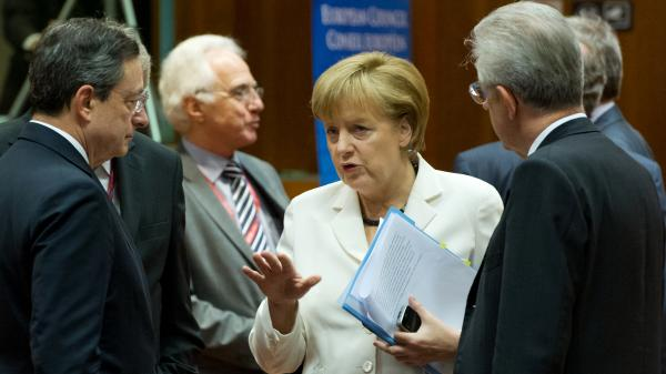German Chancellor Angela Merkel talks with European Central Bank President Mario Draghi (left) and Italian Prime Minister Mario Monti (right) during a summit of European leaders in Brussels. They reached an agreement on a growth plan for the continent, and world markets surged.
