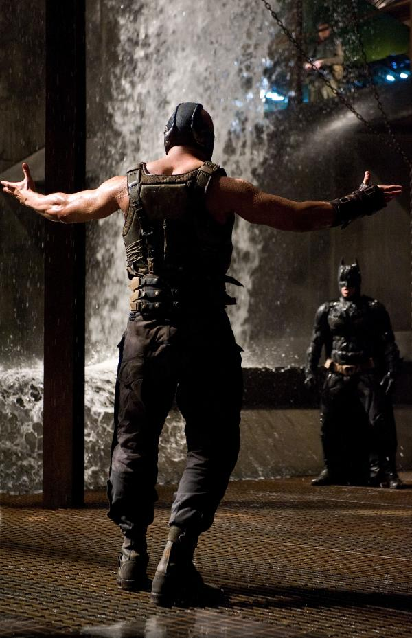 Tom Hardy as Bane and Christian Bale as Batman in <em>The Dark Knight Rises</em>.